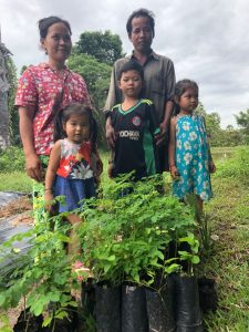 happy family with young moringa trees in Kampong Thom province